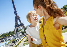 Mother and daughter taking selfie in front of Eiffel tower Royalty Free Stock Photography