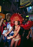 Having fun together. Samba girl dance danced with visitors with great smile in the Lan Kwai Fong festival in Hong Kong Royalty Free Stock Photo