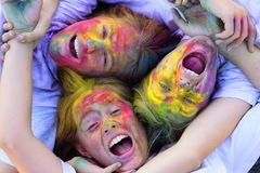 Having fun together. Crazy hipster girls. Summer weather. colorful neon paint makeup. children with creative body art stock photography