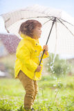 Having fun under the rain, emotional little girl Stock Photo