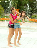 Having fun in the water fountain Royalty Free Stock Photography