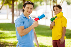 Having fun with water guns Stock Image