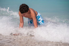 Having fun in waves. Playinf on waves, Myrthos beach, Kefalonia, Greece Stock Images