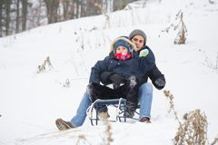 Having fun in the winter. Mother and son on a sledge Stock Photos