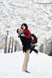 Having fun in winter scene. Young pretty woman and boy walking in winter park. happiness couple. Happy winter travel couple