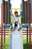Having fun while young. A young smiling girl playing at the park Royalty Free Stock Images