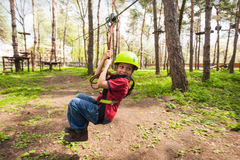 Having fun on zip line. Young boy having fun on a zip line in park stock images