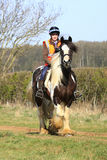 Having a good time. Young woman out on a pleasure ride through the countryside Stock Photography