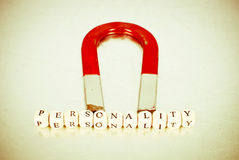Having a Great Personality. Large Red Magnet And Word Personality stock images
