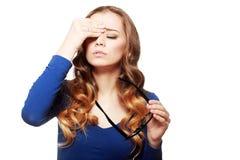 Having headache pains. Portrait of young businesswoman having headache pains Stock Images