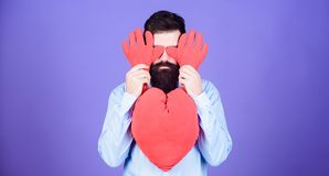 Having heart attack and heartache. Valentines man expressing love on 14 february. Love sickness and heart problems. Bearded man holding big red heart. Cordial royalty free stock photography