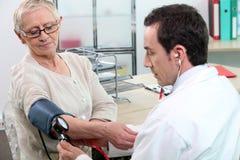Having her blood pressure taken stock image