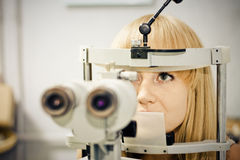 Having her eyes on a slit lamp Stock Photo
