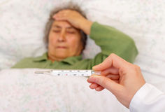High fever and headache. Having high fever and headache because getting flu Stock Photo