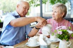 Having hot tea Royalty Free Stock Images