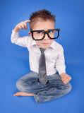 Having an idea. Six years thoughtful boy wearing geek glasses Stock Photography