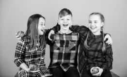 Having joyful feelings and positive emotions. Happy children. Happy little kids laughing and smiling together. Happy. Small girls and boy holding red apples royalty free stock image