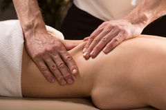 Having lower back massage Stock Images