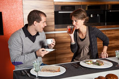 Having lunch. Cute young couple having lunch together in the cafetaria Royalty Free Stock Photo