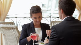 Having lunch with business partner stock video footage