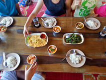 Having Lunch Together. A family members are having lunch / dinner together at Waterview Restaurant Danok Thailand Royalty Free Stock Images