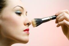 Having make-up. Portrait of pretty girl having make-up royalty free stock photos