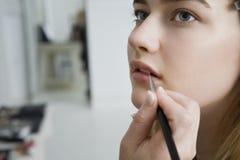 Having Makeup Applied di modello Fotografie Stock