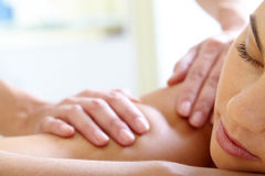 Having massage. Part of face of calm female having massage Royalty Free Stock Images