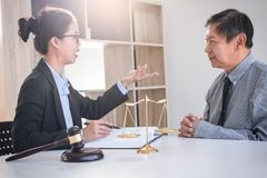 Having meeting with team at law firm, Consultation between a fem. Ale lawyer and businesswoman customer, tax and contract the company of real estate concept Stock Images