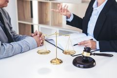 Having meeting with team at law firm, Consultation between a fem. Ale lawyer and businesswoman customer, tax and contract the company of real estate concept Stock Image