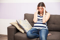 Having migraines during pregnancy royalty free stock image