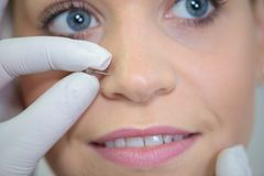 Having a nose piercing. Piercing stock photography