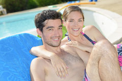 Having picture beside swimming pool Royalty Free Stock Image