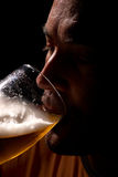Having a pint. Guy enjoying is cold pint after a hot day stock photos