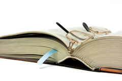 Having a rest. Bookmark in the thick book Royalty Free Stock Photos