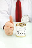 Having a retirement fund is a good idea. Retirement fund concept with senior hand showing thumbs up sign - closeup Royalty Free Stock Photo