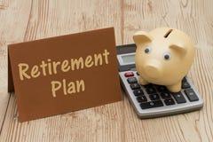 Having a retirement plan, A golden piggy bank, card and calculat Stock Image