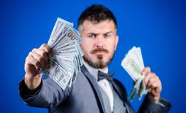 Having a rewarding job. Making money with his own business. Bearded man holding cash money. Currency broker with bundle royalty free stock images