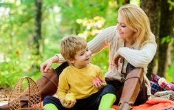 Having snack during hike. Happy childhood. Mom and kid boy relaxing while hiking forest. Family picnic. Mother pretty stock image