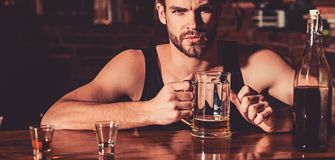 Having some beer. Alcohol addict with beer mug. Man drinker in pub. Handsome man drink beer at bar counter. Beer royalty free stock photography