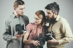 Having some problems. Group of photographers with retro cameras. Retro style woman and men hold analog photo cameras. Having some problems. Group of royalty free stock photos