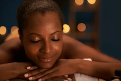 Having spa treatment. Face of beautiful African-American woman with perfect skin having spa treatment Royalty Free Stock Photography