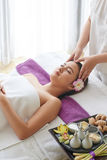 Having Spa Weekend. Portrait of attractive young women getting massage treatment while spending weekend in spa salon royalty free stock photography