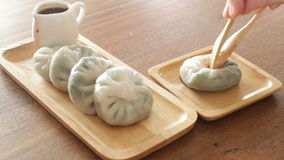 Having steamed dumpling stuff on wooden plate stock video footage