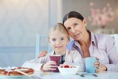 Having tea with snack Stock Photo