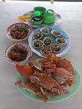 Having Vietnamese grilled mussels and crabs for lunch royalty free stock photo