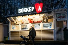 Clients near the fast food kiosk in a winter park. Moscow. Russia. royalty free stock photography