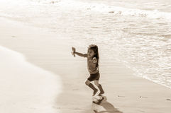 Beautiful Little Asian Girl Running on the Beach Stock Photography