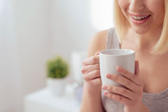 Having a wonderful cup of hot coffee Royalty Free Stock Image