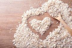 Havre och hjärta i en träbakgrund Royaltyfria Bilder